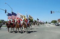 North Main Street was treated to a mini-parade courtesy of the 102nd California Rodeo Salinas, which opened Thursday night, July 19 for a four-day run.