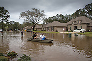 Covington Louisiana, March, 12, 2016,  People evacuate the Tallow Creek subdivision by boat Saterday afternoon.14 inches of rain fell in less than 24 hours, after three days of intermittent rain, causing flash floods. The Tchefuncte River and Bogue Falaya River<br />  crested on Saturday morning but the flood event continued into the night for those in Tallow Creek.