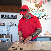 Kevin Rodriguez cutting out fondant props for a birthday cake at I Knead Sugar Friday afternoon in Gallup. I Knead Sugar was named a Star Business by the Small Business Development Center at UNM-Gallup.