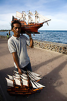 Model ship vendor on Rizal Boulevard in Dumaguete overlooking the port.  Vendors of all sort of things, including guitars, mangos, coconuts, peanuts roam the streets in most towns in the Philippines.