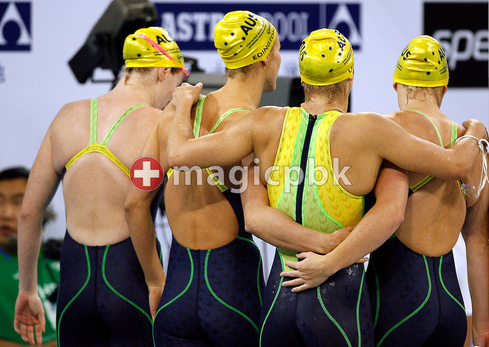 (L-R) Danni MIATKE, Sophie EDINGTON, Lisbeth LENTON and Shayne REESE of Australia walk away holding each other after winning the silver medal in the women's 4x100m Freestyle Relay Final during day four of the 8th FINA World Swimming Championships (25m) held at Qi Zhong Stadium April 8th, 2006 in Shanghai, China. (Photo by Patrick B. Kraemer / MAGICPBK)