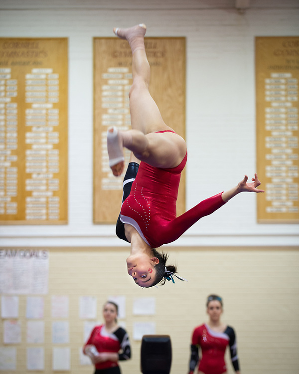 Natalia Nottingham performs an aerial on the balance beam during Cornell Gymnastics' meet against the University of Pennsylvania at Teagle Hall in Ithaca, New York on February 3 2018.