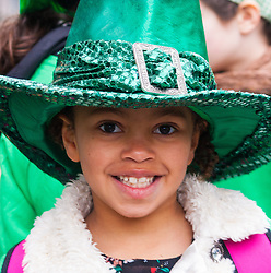 London, March 15th 2015. Hundreds of London's Irish community as well as South and central Americans, Scots and English people of all ages participare in the annual St Patric's Day Procession through the capital to Trafalgar Square.