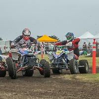 Young riders race four-wheeled ATV's at Dream Machines, Half Moon Bay Airport, California.