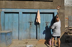 April 4, 2017 - Kathmandu, NP, Nepal - A Priest ready for taking holy bath before carrying idol Seto Machindranath towards chariot for the annual festival of Seto Machindranath Chariot festival at Kathmandu, Nepal on Tuesday, April 04, 2017. Devotees celebrates weeklong festival of idol Seto Machindranath for timely rainfall and good harvest. (Credit Image: © Narayan Maharjan/NurPhoto via ZUMA Press)