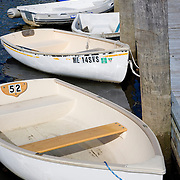 Dinghies tied to the dock at the Ellsworth Harbor public boat landing.