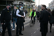 Police asking people to move on in Broadway Market during the second coronavirus national lockdown on November 7th 2020 Hackney, East London, United Kingdom. The UK Government introduced a 4 week lockdown from November 5th - December 2nd to combat the coronavirus outbreak. It is the third day of the national lockdown and restrictions mean that people are only allowed to meet outside, in pairs and only if keeping social distance. Only if they already live together or have formed a social bubble can they interact freely.