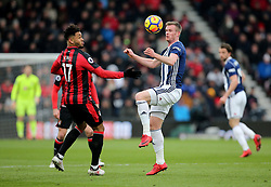 West Bromwich Albion's Chris Brunt (right) and AFC Bournemouth's Joshua King (left) battle for the ball during the Premier League match at the Vitality Stadium, Bournemouth.