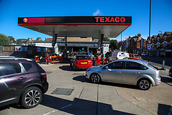 © Licensed to London News Pictures. 03/10/2021. London, UK. Motorists queue for the tenth day at Tesco petrol station in north London as the fuel crisis continues. The petrol station has run out of petrol and has limited supply of diesel, which will last until 2pm today. From tomorrow (4 October) military personnel, including 100 drivers, will start fuel deliveries. <br /> Photo credit: Dinendra Haria/LNP