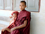 Portrait of two Buddhist novice monks in a PaO village on 24th March 2016 in Kayah State, Myanmar