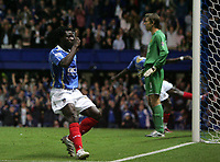 Photo: Lee Earle.<br /> Portsmouth v Manchester United. The FA Barclays Premiership. 15/08/2007.Portsmouth's Benjani (L) celebrates after scoring their first goal as United keeper Edwin Van Der Sar (R) looks frustrated.