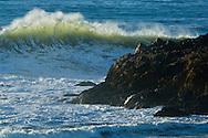 Powerful ocean waves breaking next to coastal rocks, Pescadero State Beach, San Mateo County coast, California