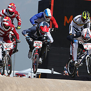 Edzus Treimanis, Latvia, (front, left), Liam Phillips, Great Britain, (front, centre) and Connor Fields, USA, (front, right) in action during the Cycling BMX Finals Day during the London 2012 Olympic games. London, UK. 10th August 2012. Photo Tim Clayton