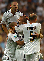 England's David Beckham is congratulated by teammate Zinedine Zidane, Roberto Carlos (hidden) and Raul Bravo (up) after Beckham scored the only goal, Spanish LIga Real Madrid-Numancia. September, 11, 2004. Photo Alvaro Hernandez.<br /> <br /> Graffiti