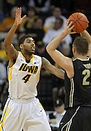 February 27 2013: Purdue Boilermakers guard/forward D.J. Byrd (21) looks to pass over Iowa Hawkeyes guard/forward Roy Devyn Marble (4) during the first half of the NCAA basketball game between the Purdue Boilermakers and the Iowa Hawkeyes at Carver-Hawkeye Arena in Iowa City, Iowa on Wednesday, February 27 2013.