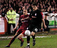 Photo: Leigh Quinnell.<br /> Tamworth v Stoke City. The FA Cup. 17/01/2006. Stokes Lewis Buxton is followede by Tamworths Nick Wright.