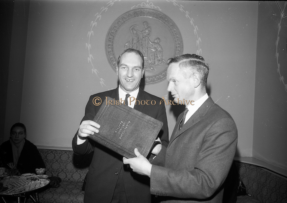 18/2/1966<br /> 2/18/1966<br /> 18 February 1966<br /> <br /> Mr. Martin Colley T.D. Minister for Education receiving the details of the scholarships from Mr Redmond J. Murphy Chariman of Bolands Ltd at the Reception