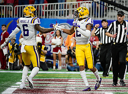 LSU Tigers wide receiver Justin Jefferson (2) celebrates with wide receiver Terrace Marshall Jr. (6) after scoring a touchdown during the first half against Oklahoma Sooners in the 2019 College Football Playoff Semifinal at the Chick-fil-A Peach Bowl on Saturday, Dec. 28, in Atlanta. (Vasha Hunt via Abell Images for the Chick-fil-A Peach Bowl)