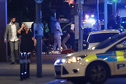 © Licensed to London News Pictures. 03/06/2017. London, UK. Emergency services are seen near Borough Market after reports of an incident involving a vehicle and pedestrians in London Bridge.  Reports are saying a white transit van may have deliberately run down people crossing the bridge. Photo credit: Tolga Akmen/LNP