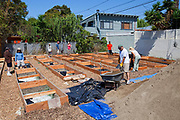 July 24, 2010. Final preparations are made to the planting beds at the Venice Community Garden. The Venice Garden broke ground in April, 2010. Soil tests revealed high levels of arsenic and lead because of previous uses which included a railroad line going through the lot. Steps were taken which included adding protective layers and adding new soil. Planting began in August and the first harvest was in October, 2010. Venice, California, USA