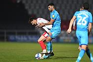 Stevenage midfielder Elliot Osborne(8) and Cheltenham Town Midfielder Conor Thomas (7) battles for possession during the EFL Sky Bet League 2 match between Stevenage and Cheltenham Town at the Lamex Stadium, Stevenage, England on 20 April 2021.