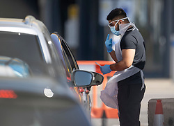 © Licensed to London News Pictures. 21/04/2020. London, UK. Testing for the coronavirus starts for the day at a centre in the car park of a north London Ikea. The public have been told they can only leave their homes when absolutely essential, in an attempt to fight the spread of the coronavirus COVID-19 disease. Photo credit: Peter Macdiarmid/LNP