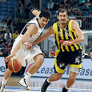 Efes Pilsen's Kerem GONLUM (L)  and Fenerbahce's Kaya PEKER (R) during their Turkish Basketball Legague Play-Off semi final second match Efes Pilsen between Fenerbahce at the Sinan Erdem Arena in Istanbul Turkey on Friday 27 May 2011. Photo by TURKPIX