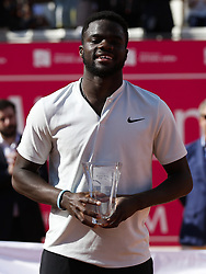 May 6, 2018 - Estoril, Portugal - North-American tennis player Frances Tiafoe holds his trophy during an award ceremony after winning the Millennium Estoril Open ATP Singles tournament in Estoril, near Lisbon, on May 6, 2018. (Credit Image: © Carlos Palma/NurPhoto via ZUMA Press)