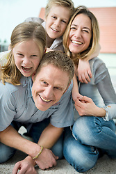 Happy family with two kids at home