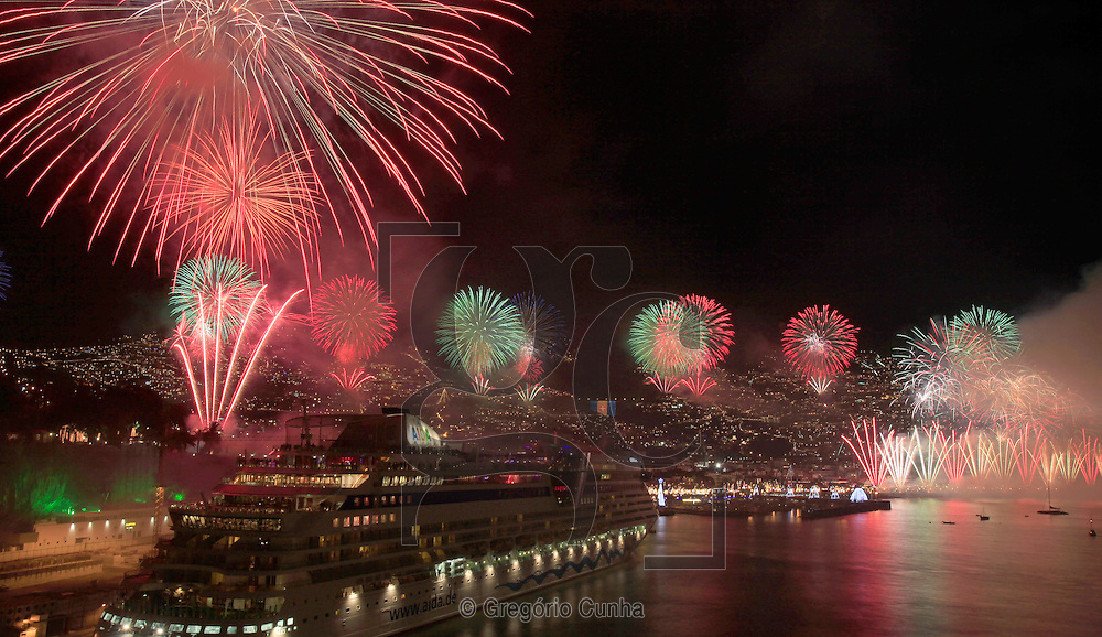 Fireworks light up the sky above Funchal Bay, Madeira Island, to celebrate the arrival of the New Year on January 1.<br /> Photo Gregório Cunha