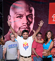 April 28.2015. Las Vegas NV. Manny  Pacquiao(C) with his trainer Freddi Roach(L) arrives for the fans Tuesday at the Mandalay Bay. Manny  Pacquiao  will be fighting Floyd Mayweather Jr. the long awaited fight in May 2nd at the MGM grand hotel.<br /> Photo by Gene Blevins/LA DailyNews