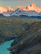 Cerro Torre and Cerro Chaltén (Fitz Roy) at sunrize from the rio de Las Vueltas canyon in Patagonia.