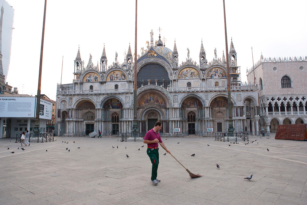 Piazza San Marco at dawn with street sweeper, Venice, Italy