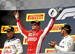 October 21, 2018 - Austin, Texas, U.S. - Race winner KIMI RAIKKONEN, center, (Scuderia Ferrari) celebrates during the podium ceremony with 2nd place MAX VERSTAPPEN, left, (Red Bull Racing) and 3rd place LEWIS HAMILTON (Mercedes AMG Petronas F1 Team) after the Formula One United States Grand Prix, at Circuit of The Americas.  (Credit Image: © Hoch Zwei via ZUMA Wire)