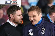 Scunthorpe United Manager Graham Alexander shares a joke with AFC Wimbledon manager Neal Ardley  during the EFL Sky Bet League 1 match between Scunthorpe United and AFC Wimbledon at Glanford Park, Scunthorpe, England on 28 February 2017. Photo by Simon Davies.