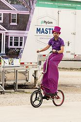 2021-08-06 McLean County 4H Fair.<br /> <br /> Man using hidden stilts to ride a tall modified bicycle