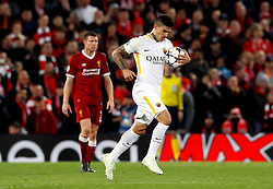 AS Roma's Diego Perotti collects the ball from the net to run back to the centre circle after scoring his side's second goal of the game from the penalty spot