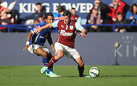 Leicester City's Liam Moore (L) and Burnley's Lukas Jutkiewicz in action during todays match  <br /> <br /> Photographer Jack Phillips/CameraSport<br /> <br /> Football - Barclays Premiership - Leicester City v Burnley - Saturday 04th October 2014 - King Power Stadium - Leicester<br /> <br /> © CameraSport - 43 Linden Ave. Countesthorpe. Leicester. England. LE8 5PG - Tel: +44 (0) 116 277 4147 - admin@camerasport.com - www.camerasport.com