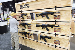 Booth attendant sets up display at the 2017 NRA Annual Meetings and Exhibits in Atlanta
