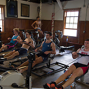 Competetive rowers work out indoors at a boathouse on The Charles River in Cambridge