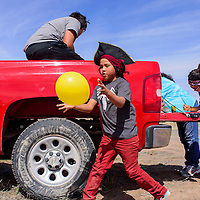 Luke Sam chases an errant balloon during a parade in Sanders Friday.