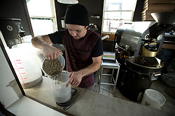 Devout Coffee co-owner and chief roaster Stevie Pape uses a scale to measure out a 10-pound batch of Ethiopian coffee beans for roasting, Tuesday, April 5, 2016, in Fremont, Calif. (Photo by D. Ross Cameron)