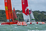 SailGP Team Japan and Team China rounding the top mark in race one. Race Day. Event 4 Season 1 SailGP event in Cowes, Isle of Wight, England, United Kingdom. 11 August 2019: Photo Chris Cameron for SailGP. Handout image supplied by SailGP