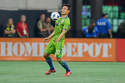 July 15, 2018 - Atlanta, GA, U.S. - ATLANTA, GA Ð JULY 15:  Seattle's Kim Kee-hee (20) settles the ball during the match between Atlanta and Seattle on July 15th, 2018 at Mercedes-Benz Stadium in Atlanta, GA.  Atlanta United FC and Seattle Sounders FC played to a 1 Ð 1 draw. (Photo by Rich von Biberstein/Icon Sportswire) (Credit Image: © Rich Von Biberstein/Icon SMI via ZUMA Press)