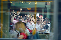 Photo: Chris Ratcliffe.<br /> England v Paraguay. Group B, FIFA World Cup 2006. 10/06/2006.<br /> England Fans get in the mood for the game as a tram passes by in Frankfurt.