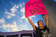 15 AUGUST 2012 - PHOENIX, AZ:  A girl in front of the Arizona State Capitol Wednesday. About 200 people, mostly DREAM Act  (an acronym for Development, Relief, and Education for Alien Minors) students and their family members, marched on the Arizona State Capitol in Phoenix Wednesday after Arizona Governor Jan Brewer said the state of Arizona will not give DREAM Act students any state services, including driver's licenses or tuition breaks on state universities and schools. Brewer has been a critic of President Obama's plan to defer deportations of certain undocumented young people.  PHOTO BY JACK KURTZ