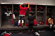 Steve Garlock #66 of Iraan High School football team puts his name on his locker before kickoff for the state championship game at AT&T Stadium in Arlington, Texas on December 15, 2016. (Cooper Neill for The New York Times)