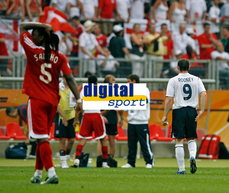 Photo: Glyn Thomas.<br />England v Trinidad & Tobago. Group B, FIFA World Cup 2006. 15/06/2006.<br /> England's Wayne Rooney (R) leaves the field at full time.