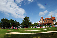 Sep 13, 2014; Atlanta, GA, USA; An overall view of the ninth green and club house as Cameron Tringale plays from the bunker during the third round of the Tour Championship at East Lake Golf Club. Mandatory Credit: Peter Casey-USA TODAY Sports