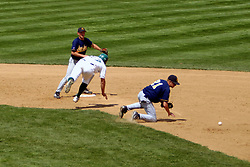 22 April 2006:  ....Titan Nick Chilczenkowski stumbles around 2nd baseman John Wagle to land safely at 2nd base.....In CCIW, Division 3 action, the Titans of Illinois Wesleyan capped the Auggies of Augustana College by a scor of 3-2 in game one of a double card afternoon.  Games were held at Jack Horenberger field on the campus of Illinois Wesleyan University in Bloomington, Illinois